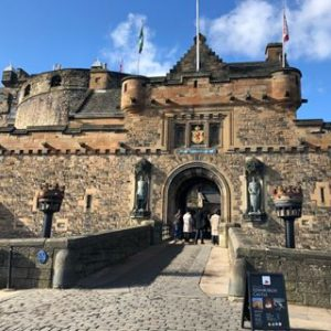 Image of Edinburgh castle taken on sunny day when Scottish foods market was set up nearby