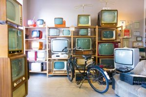Shelves upon shelves of vintage T.V's stacked in an independent shop