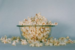 Popcorn in a glass bowl considered as healthy foods and a treat