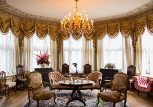 Decadent French Lounge with designer antique chairs that have undergone re-upholstery Glasgow