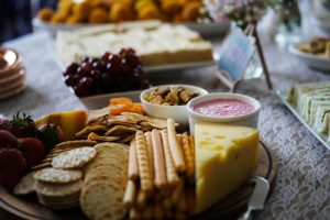 Board with cheese and crackers as healthy foods selection